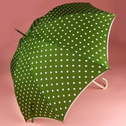 {iris-will: I can totally see Olive Snook from Pushing Daisies with this} Bella Umbrella - dark moss green and ivory polka dots, $10 rent