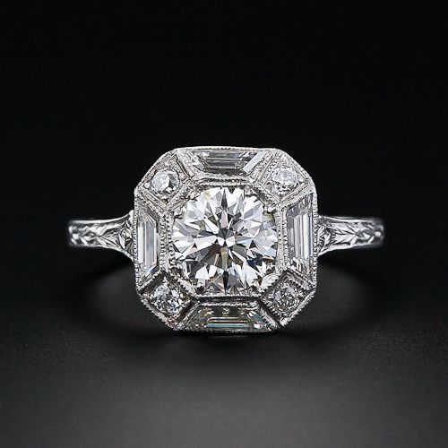 Art Deco ring with 1.01 ct round brilliant VS2/H color diamond surrounded by 4 European cut diamonds 0.12 tcw, SI/H-I alternating with 4 trapezoid cut diamonds, 0.20 tcw, VS-SI1/G-H. Platinum.