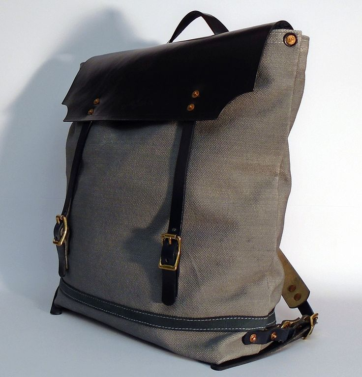 """Hand dyed cotton canvas backpack - gray with navy blue leather strap ● Size: 5,5"""" x 13,8"""" x 17,3"""" - American ● 14 cm x 35 cm x 44 cm - European ● In case of order, please contact us with the following e-mail address: info@smithandscribeco.com #cottoncanvas #backpack #handmadeineurope #handdyedcanvas #1920's #1930's #1940's #bag #canvas #copperrivet #italianleather"""