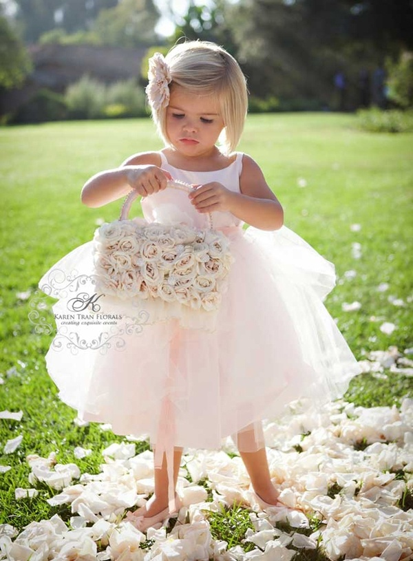 Love the white dress and flower petals, soft light from behind, beautiful!