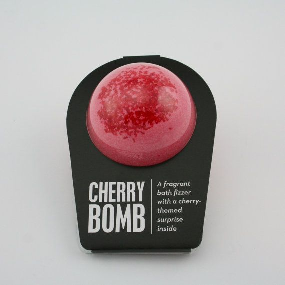 A cherry bath fizzer with a surprise inside!  This bath fizzer was created by a pair of teenage sisterpreneurs™ named Isabel and Caroline, and