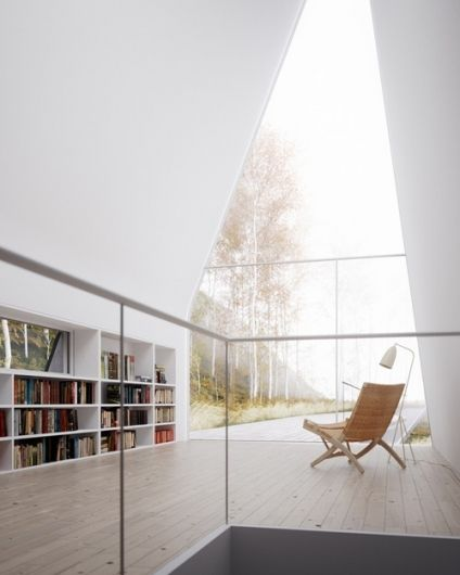 Talk about simple and clean...But the idea of a large window, reading seat, and bookcases in a loft? Yes.
