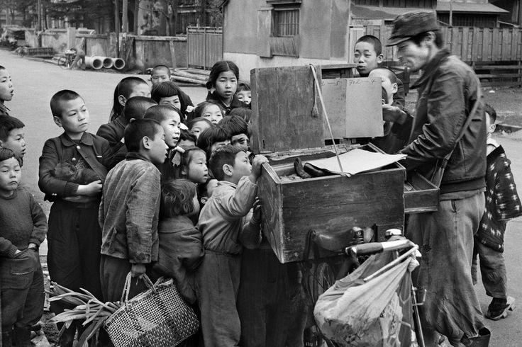 Vintage Japanese photograph. Children watching picture slideshow