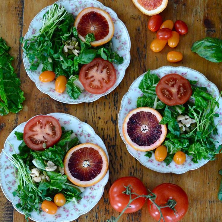 Spring Salad  Made with Swiss Chard, pea shoots, raw nuts and tomatoes and blood oranges.
