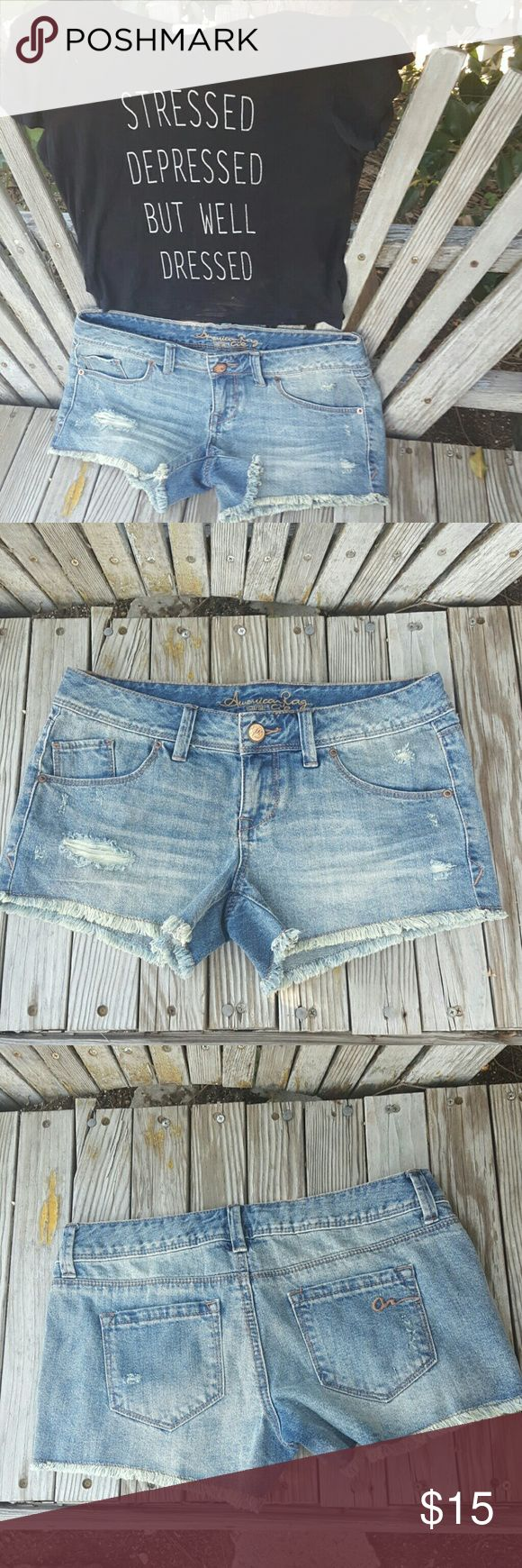 American Rag Jean Shorts Get ready fo summer with these super cute shorts by American Rag . In new condition with intentional distress in areas . Really cute says size 3 but fits like a 27 American Rag Shorts Jean Shorts