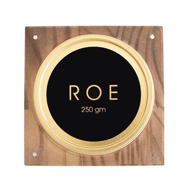 ROE Caviar's Indulge Box holds 125 or 250 grams of White Sturgeon caviar. Made of beautiful Monterey Pine wood, the Indulge Box comes with 4 mother of pearl caviar spoons and an engraved key tin opener.