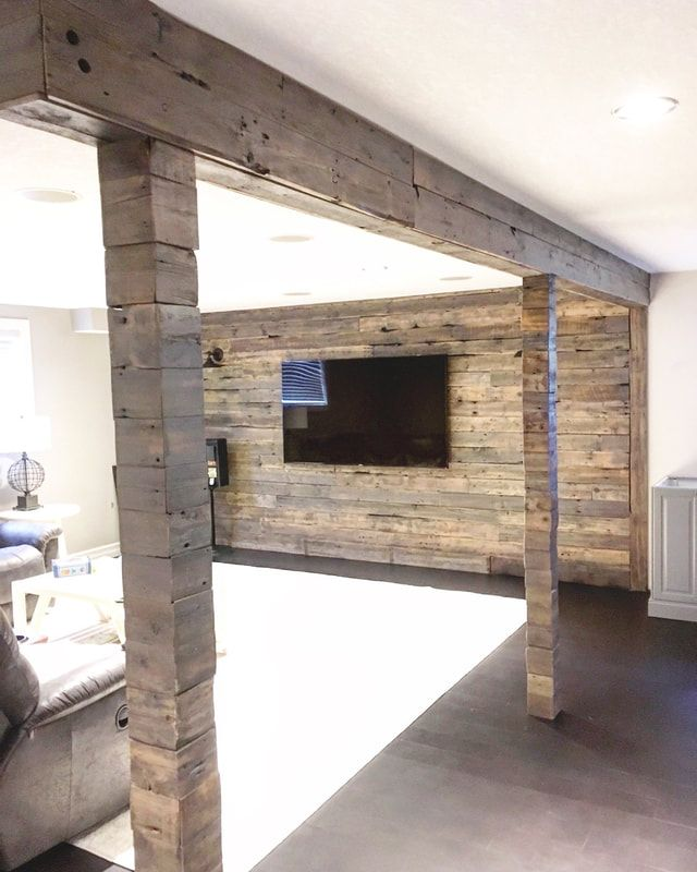 HIS & HER HOME reclaimed wood feature wall in basement reno with cladded beams and posts