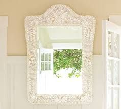 Mirror with shell surround