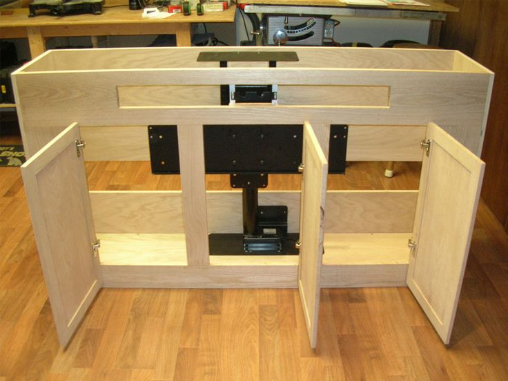 check out our built in tv cabinet which was built to hide a large big screen television