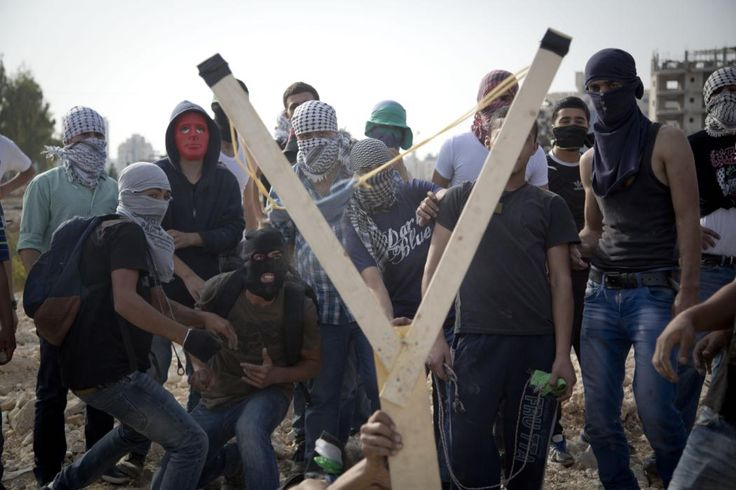 Palestinians uses a handmade large slingshot to hurl a stone during clashes with Israeli troops near Ramallah, West Bank on Oct. 12, 2015. Recent days have seen a series of stabbing attacks in Israel and the West Bank that have wounded several Israelis. Past weeks have also seen violent demonstrations in the West Bank and Gaza, and at least 16 Palestinians have been killed by Israeli forces. (AP Photo/Majdi Mohammed)