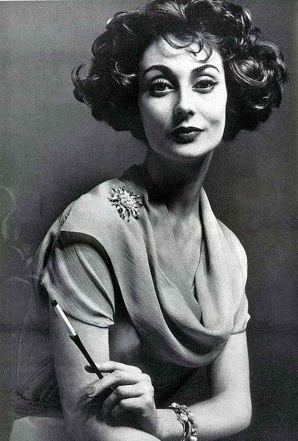 Model by:Givenchy.British Vogue,May 1957.