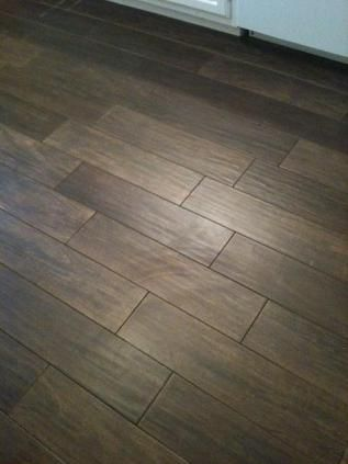 Love this wood look tile, and the random pattern it's laid in.