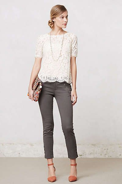 gray crops, orange wedges, cream lace top, long necklace, colorful clutch