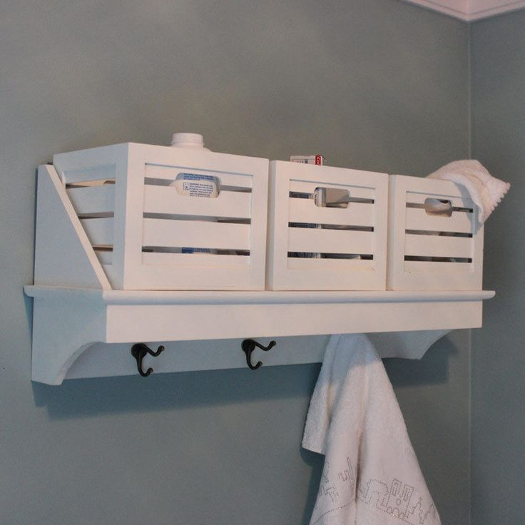 white overhead wall shelf basket storage unit coat hook