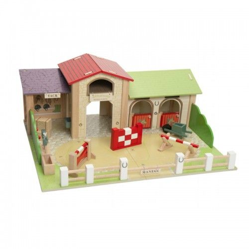Palomino Riding School   A horse yard with two stables, a barn, a tack room and three 'knock down' jumps.  The detailed design features a horseshoe motif.  Horses and characters are sold separately.