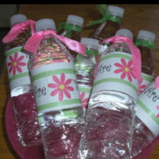 Decorated water bottle. Did this for big sis for cheer camp survival. We printed labels that matched the colors of the rest if her gift (aqua and brown) and it said Kelsey's Big Sis. We tied flavor packets to the middle if the bottle with ribbon. So easy and cute.
