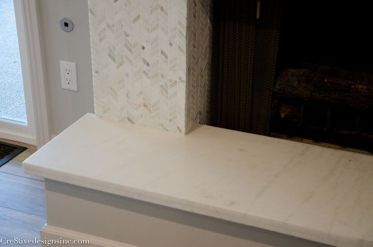 fireplace remodel with calcutta marble hearth