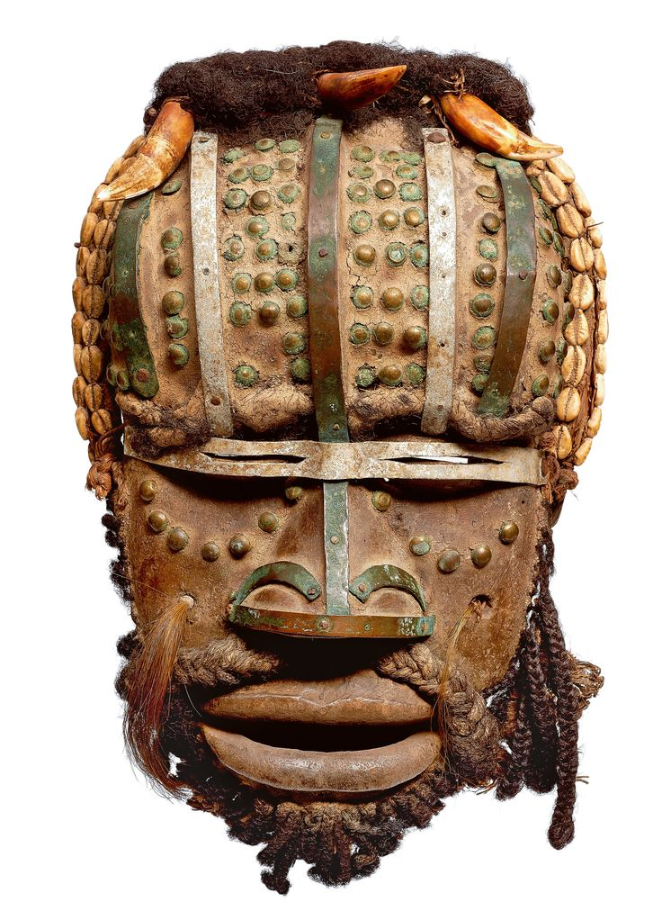 Africa | A Grebo mask, Ivory Coast/Liberia | In former times, the grè - mask of war - was supposed to encourage the warriors and to scare away the enemy sorcerer; it's now present during the funeral. All the features are emphasized to terrify: huge mouth in the shape of a muzzle, the fangs of wild animals, horns and brass mails.