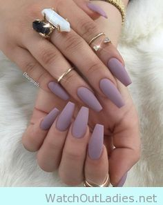 Cute long pointed taupe matte nails with quartz rings