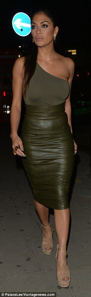 Beyond sexy: The stunning X Factor judge, 38, was dressed to impress in a racy leather skirt and very sexy olive one-shoulder top and leather skirt