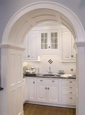 LOVE the arched doorway and subway tile!