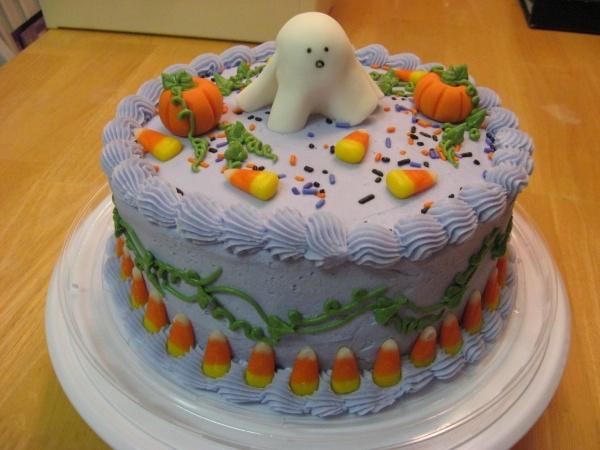 Halloween cake: Fondant ghost and pumpkins, everything else buttercream