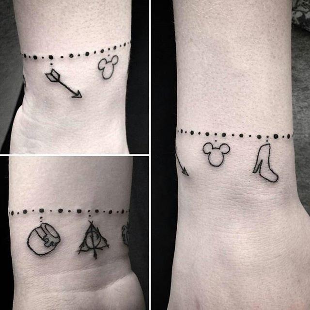 Disney charm bracelet tattoo by @lu_artsaurus  #disneytattoos #disneytattoo #disneytatts #disney #tattoos