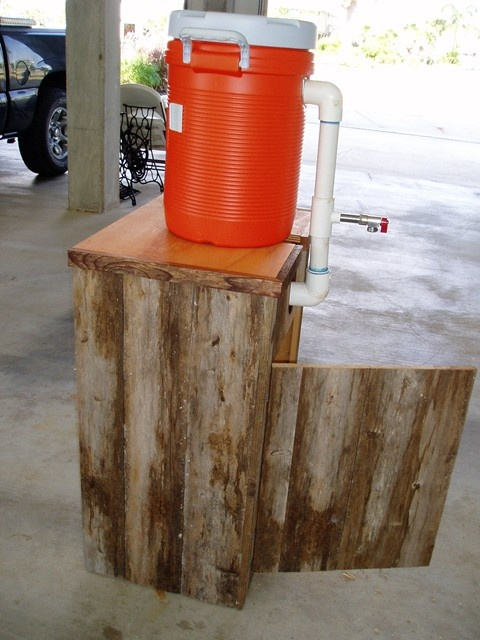 This is a redneck margarita machine. It uses a garbage disposal to crush the ice.