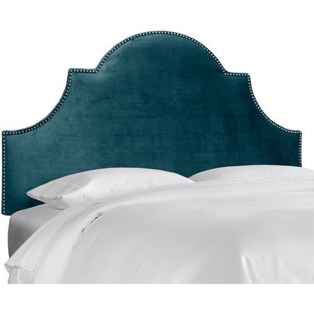 Gorgeous color!  Peacock blue upholstered headboard with nailhead trim.