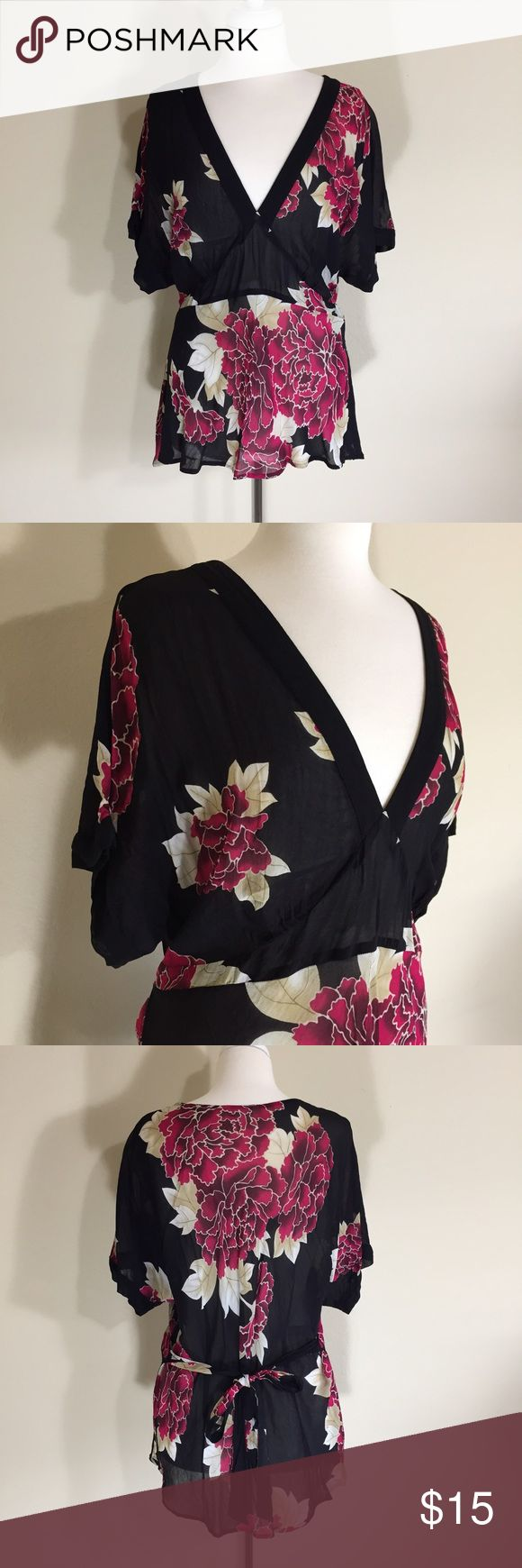 "Marks & Spencer Thin Floral Top Size UK 22 US 18 Great pre-loved condition. I can't read the fabric tag. Material is thin (see through) and it has a somewhat stiff feeling to it. 🍥 Bust - 44"" 🍥 Length - 27"" 🍥 There is a pull on the back shoulder, see picture 4. Marks & Spencer Tops Blouses"