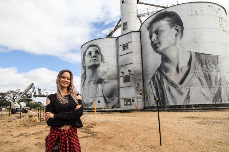 Artist Julia Volchkova in front of Rup's silos featuring Ebony Baker & Jordan Weidermann Photo: ABC's Larissa Romensky