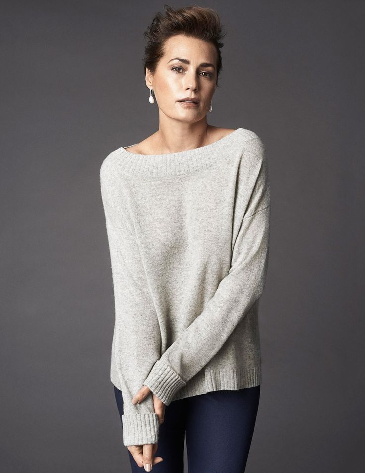 audrey-cashmere-jumper-Grey-melange nspired by   great style icon Audrey Hepburn.    It has been designed with long sleeves which are finished with ribbed, turn back cuffs and a wide neckline for an ideal, generous boxy fit. A timeless treat, this piece has a super-soft finish and epitomises luxurious quality. Matching cashmere wraps available.