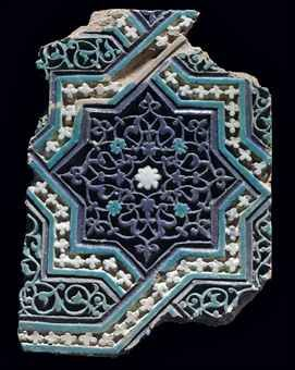 A TIMURID MOULDED POTTERY TILE PANEL