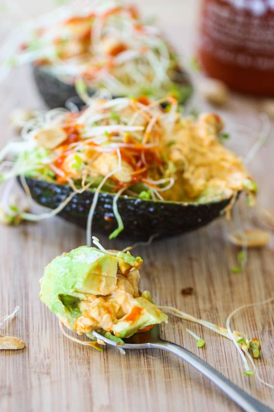 Thai Stuffed Avocados // cream cheese, sprouts, peanuts and sriracha sauce #lowcarb #protein