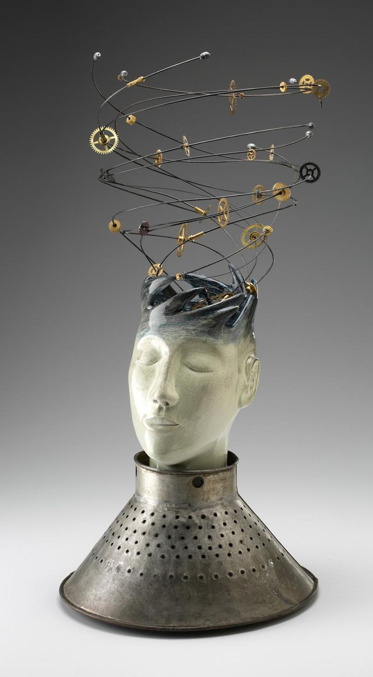 valeriebunnell.com - mixed media sculptures (tinmen, heads, women)