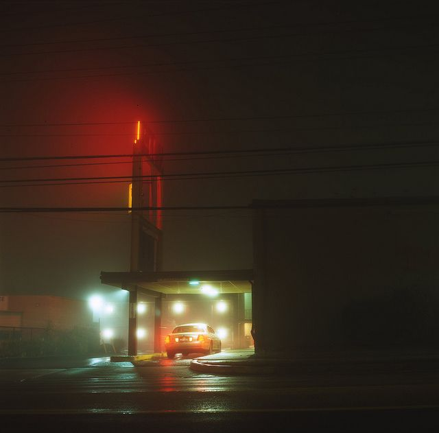 Nighttime photo - gas station in mist