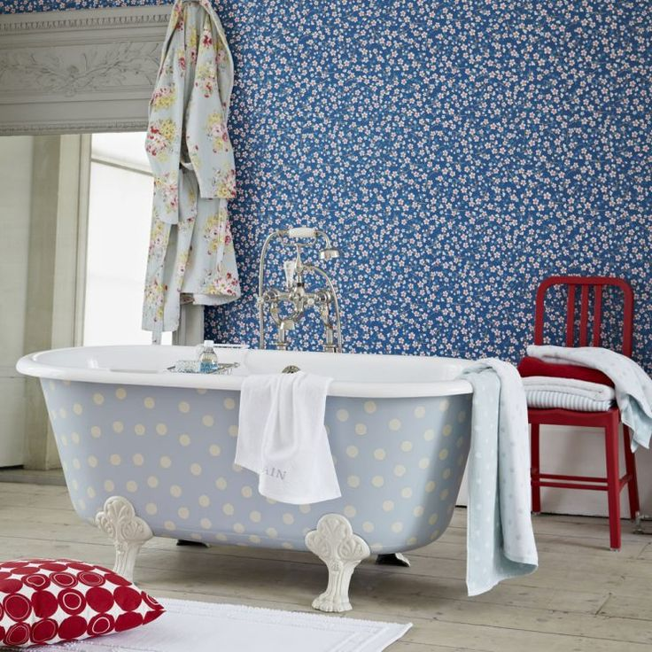 Bathroom Ideas: Blue Bathroom with Flowery Wallpaper also Classic Style Mirror Frame plus Dotted Bathtub and Red Floor Cushions