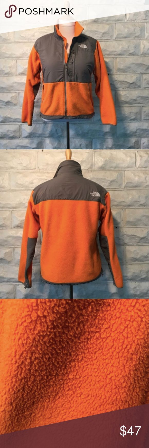 North Face: Orange and Gray Women's Denali Jacket GUC.TONS of love yet to give. Beautiful Denali Seville Orange/Asphalt Grey Jacket. Has zippers under the armpit that can be zipped open or closed to help with the changing of our body temperature. Normal wear and tear with fleece. Pictures show wear. Small snags/hole near breast pocket zipper (see photo). TONS of love yet to give. PERFECT for the fall and winter! Use ZOOM to see details. Please ask questions prior to purchase. Retails $175…