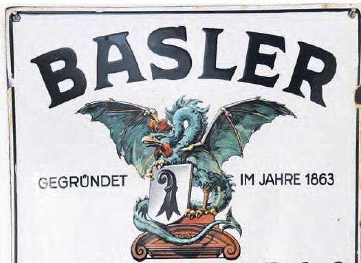 """Die Geschichte des geflügelten Wächters  Am 2. September 2013 ist in der Basler Zeitung ein weiterer Artikel von Markus von Escher, Konzernsekretär der Baloise, und dem Publizist Karl Lüönd, über die Geschichte der Baloise erschienen. Diesmal geht es um den """"geflügelten"""" Wächter der Baloise – den Basilisk. Wie es dazu kam, dass die Gründer der «Basler Feuer» den Basilisken als Schutzsymbol für ihre Kunden ernannten und wie sich der Basilisk bis in die heutige Zeit gerettet hat?"""