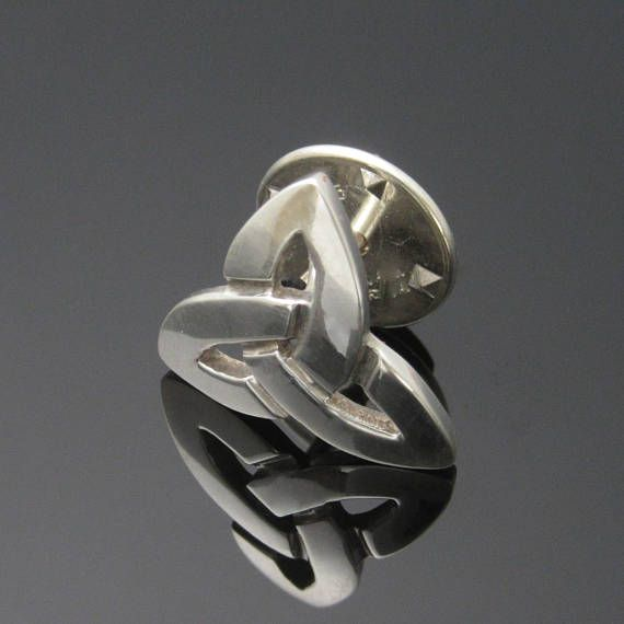 Check out this item in my Etsy shop https://www.etsy.com/ie/listing/528384107/silver-trinity-knot-tie-pin-tie-tack