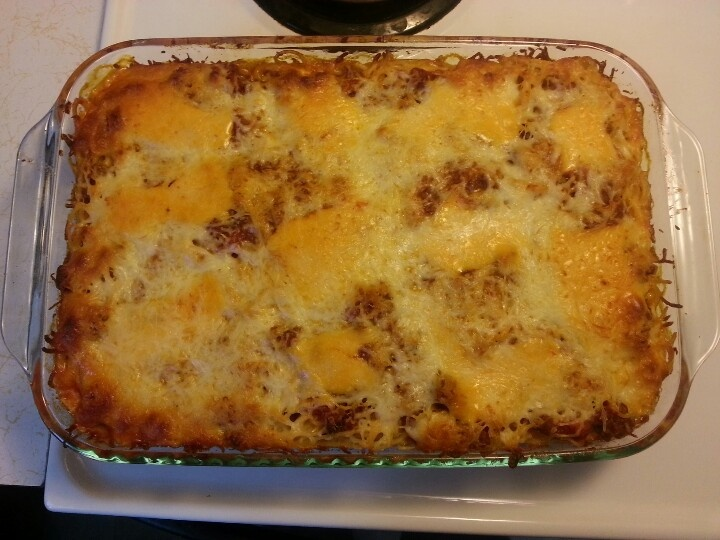 Baked Spaghetti. Big hit with the hubs & kids!!  Boil noodles. Drain. Add butter & garlic salt to noodles. Brown 1.5-2lbs of ground beef. Mix Ragu spaghetti sauce, Rotel tomatoes-Original & mushrooms to ground beef. Place a layer of noodles to bottom OF 11x9 pan. Top with meat sauce. Cut slices of velvetta cheese & place generously over sauce. Add another layer of noodles & repeat layer of sauce & cheese topping it with mozzarella cheese. Bake at 350 for 30mins & sprinkle with parmasan…