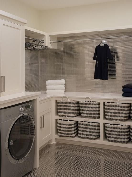 Contemporary laundry room features ivory shaker ca…