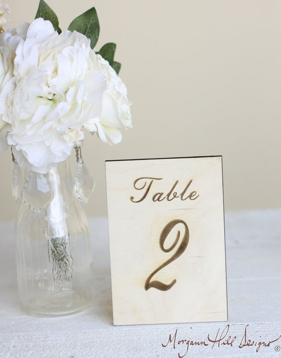 awesome Etsy listing at http://www.etsy.com/listing/154332998/rustic-table-numbers-engraved-wood