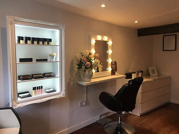 Stylish Makeup organiser beauty display cabinet with LED bright illumination and an acrylic makeup divider. White high gloss  Size and dimensions: 2 frame Height 99.8cms Width 69.4 Shelf depth 15cms Shelf heights = 15cms  The acrylic safety lip is set near the back of the cabinet to