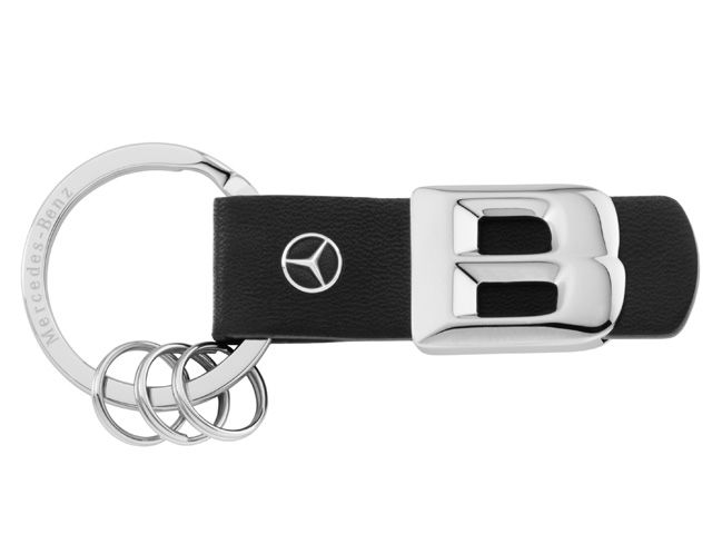 B66957941  Model series key ring. Black/silver. Leather/stainless steel.  Scale replica of lettering on rear of vehicle. Laser-engraved flat split ring.  3 mini split rings for quick replacement of keys. Star logo stud in leather.