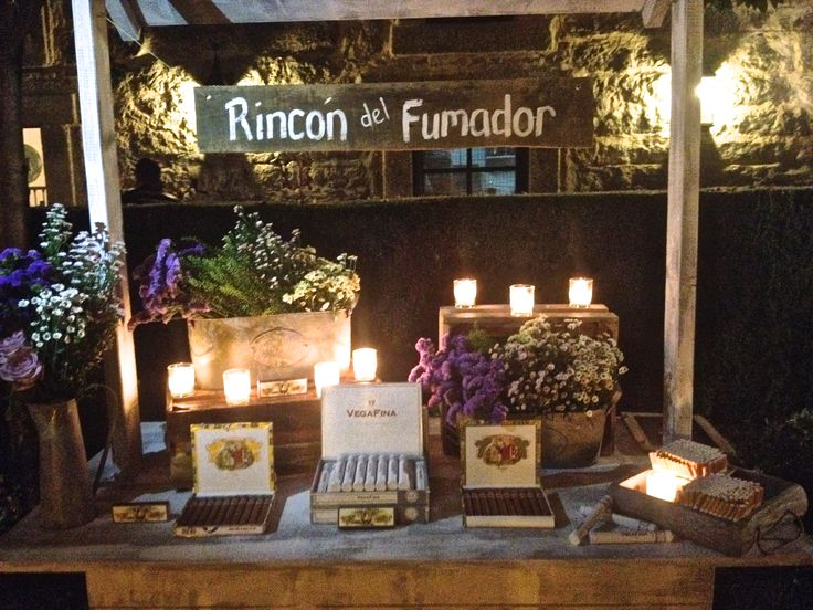 Nuestro último cigar corner decorado con velas y centros silvestres elaborados por @Mar de Flores.  by More than Events