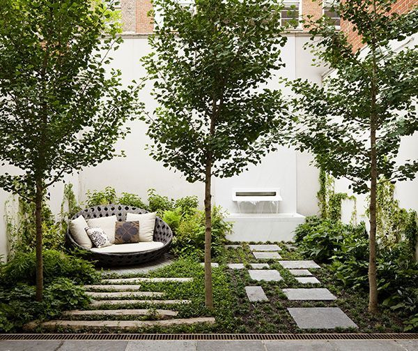 courtyard cushions trees stepping stones water feature white