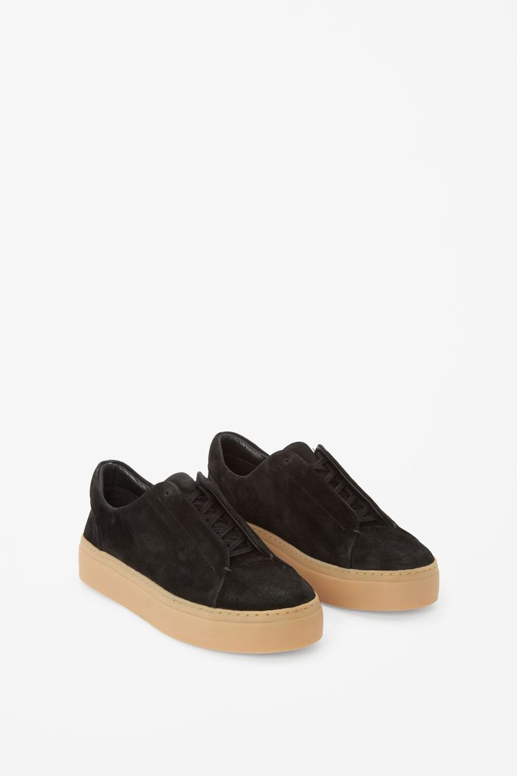 Designed with hidden lace-up holes and a contrasting, chunky rubber sole,  these sneakers are made from panels of soft brushed suede and completed  with a ...