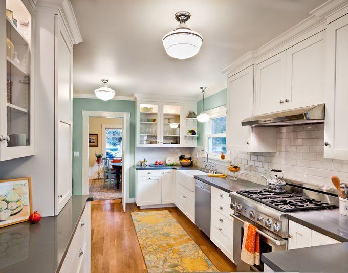 spacious white and turquoise kitchen