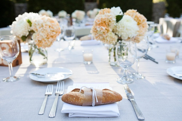 paper wrapped baguettes for guests. Gorgeous flowers and table setting